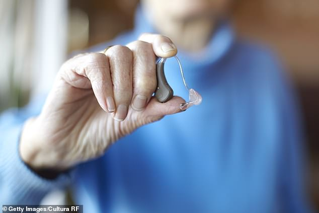 Significant hearing loss increases an individuals' risk of developing the degenerative brain disease by 90 per cent, according to studies (file photo of a hearing aid)