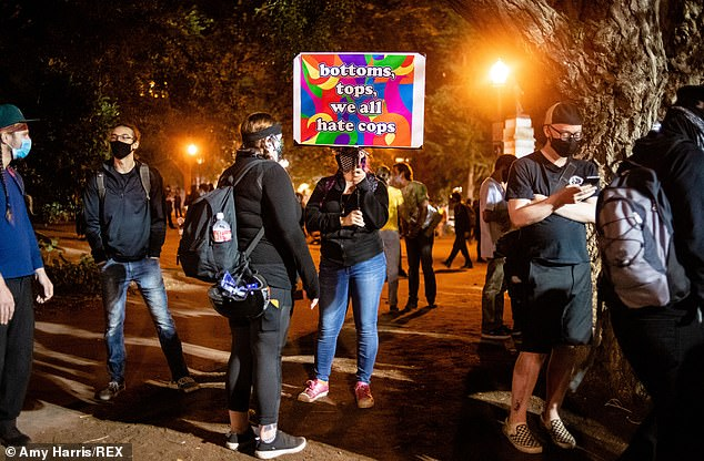 Pictured:Protesters gather at the Justice Center and Federal Courthouse in Portland, Oregon, as demonstrations continue into August