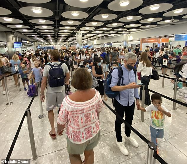 The travellers, many with young families, even chanted 'we want more staff' as the lines in the 'poorly ventilated' room stretched for at least an hour