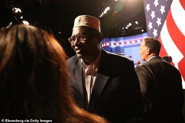 In 2016, Trump was apparently so impressed with Malik Obama's expression of support that he invited him as his guest to the presidential debate (above)