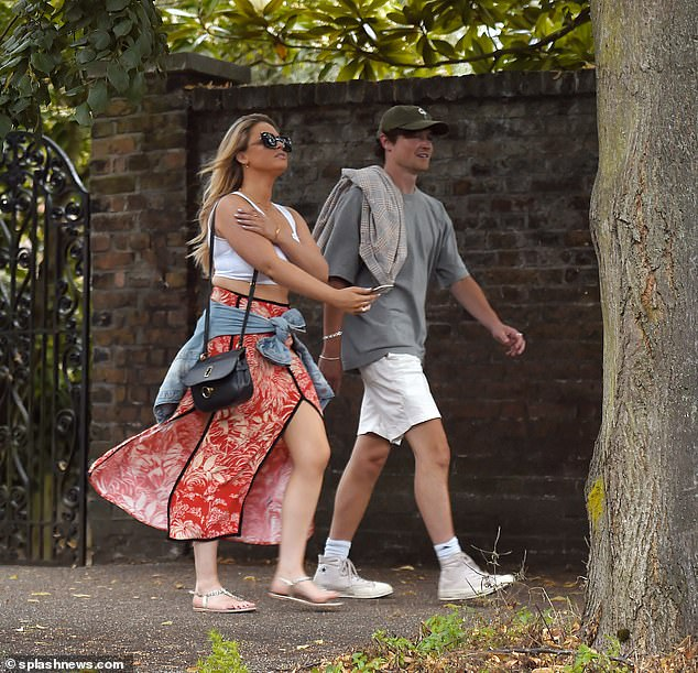 Blossoming romance: Emily Atack 'enjoys new romance with beau Joe Caro', it was reported on Saturday after the pair were seen enjoying a boozy date together on Wednesday (pictured)