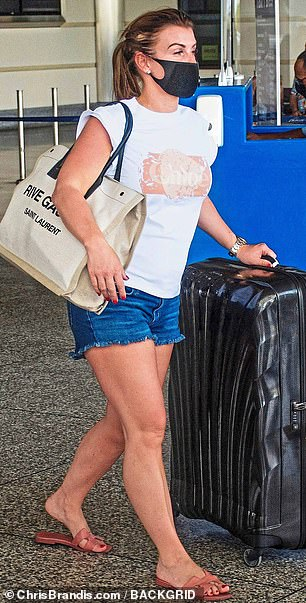 I reckon that once you¿re checking in a case, you might as well cram in absolutely everything you could possibly need or want. Coleen Rooney is pictured above arriving in Barbados