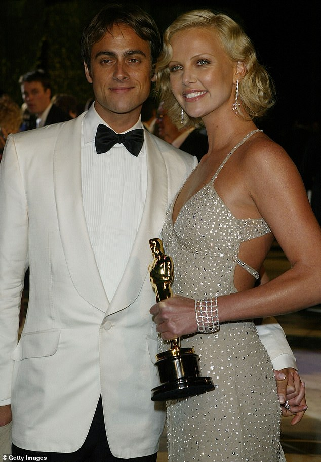 Side by Side: The 44-year-old actress broke up with her last living boyfriend, Stuart Townsend, ten years ago; they are pictured together in 2004