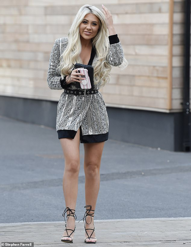 Gorgeous:Paige Turley put together another winning look as she wore a sequined silver blazer dress with strappy heels on Saturday evening