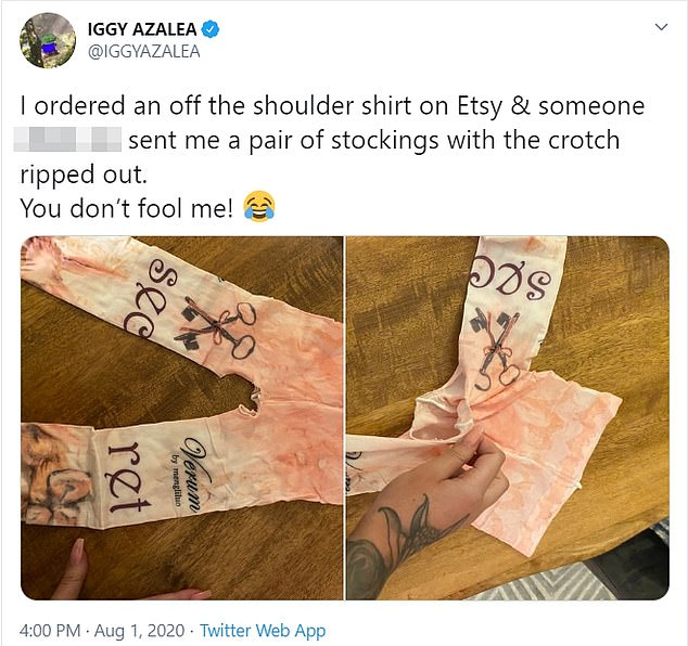 Not what the rapper ordered! 'I ordered an off the shoulder shirt on Etsy & someone dead a** sent me a pair of stockings with the crotch ripped out,' a bamboozled Iggy Tweeted next to two picture of the offending garment