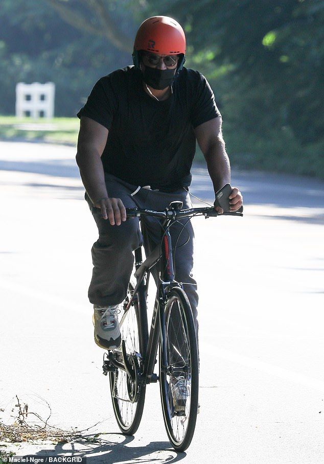Athletic:Rodriguez showed off his buff biceps in a black tee as he held on tightly to the handle bars of his black and red bicycle