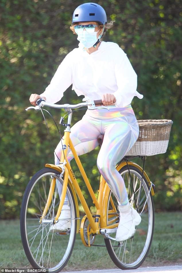 Jennifer Lopez dons holographic leggings as she enjoys a bike ride with fianceAlex Rodriguez