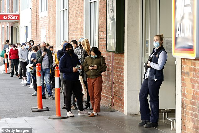 A long queue lines up outside Melbourne's South Market on Sunday