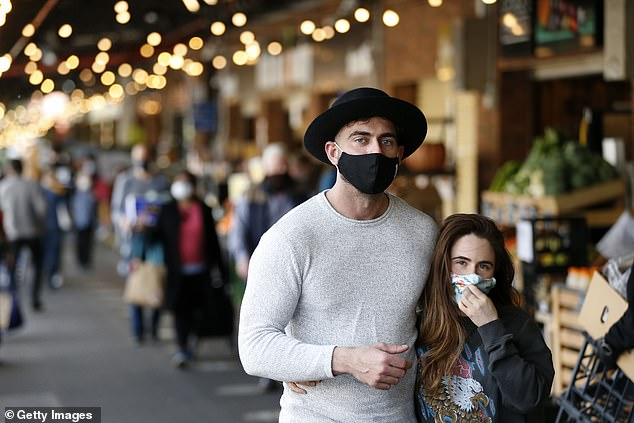 Prime Minister Daniel Andrews is expected to announce more than 650 new positive tests as the worsening crisis in the state shows no signs of ending (pictured, shoppers wearing face masks visit the South Melbourne market on Sunday)