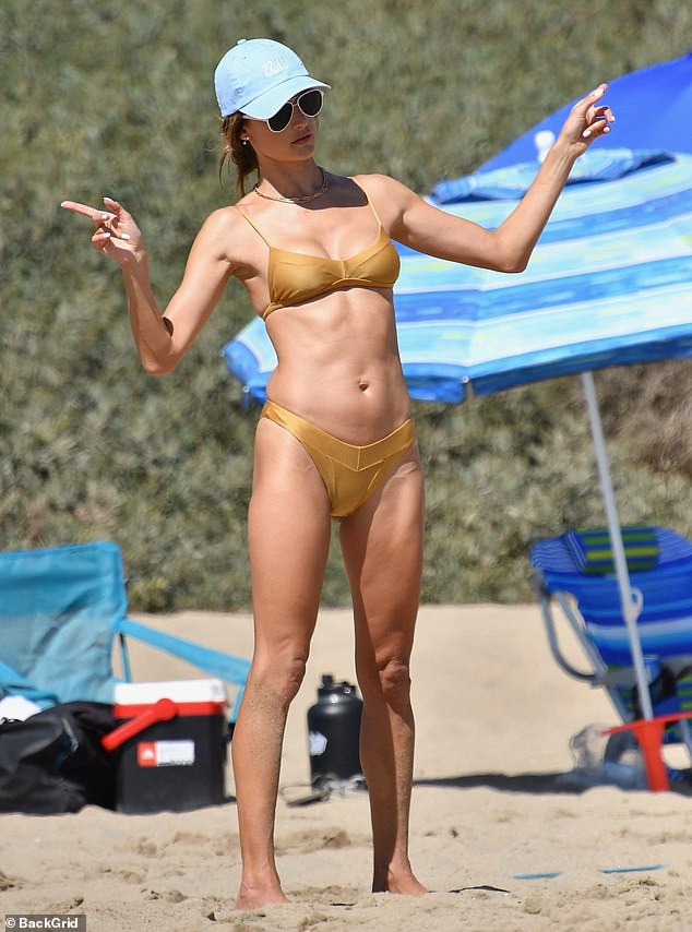 Killing it:Alessandra was impressed by her own volleyball skills as she copped a cheeky pose at the rival team