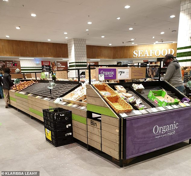 The vegetable section of a Woolworths store in Melbourne is nearly empty as panicked people shop on Sunday