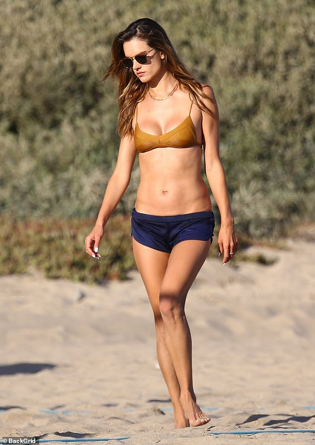 Switching things up:As the sun began to set, Alessandra's freshly dried tresses were let loose from under her hat and she threw on a pair of deep purple mini shorts