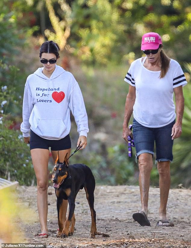Furry friend:The 24-year-old model was also accompanied by her darling Doberman Pinscher named Pyro as she braved the trail in red flip flops