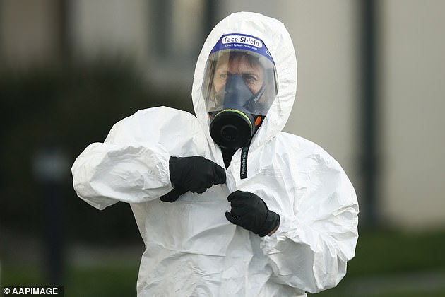 Victoria extended the lockdown until September 13 (pictured, a clinical waste removal personnel at St Basil's Homes for the Aged in Fawkner, Melbourne)