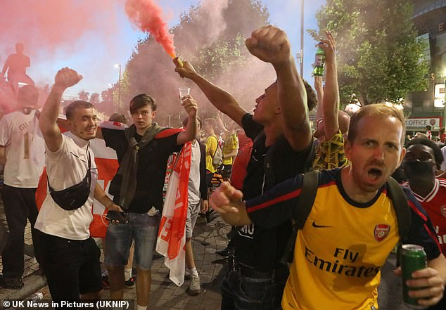 Gunners fans launched flares and chanted near each other on Saturday night