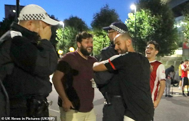 Police attended the celebrations with a supporter hugging a patrolling officer