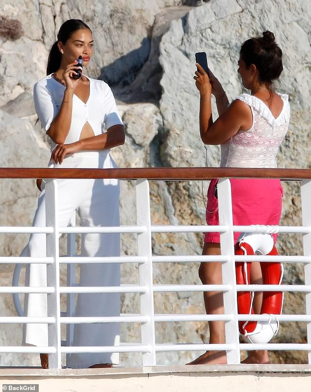 Smouldering: Shanina also took advantage of the beautiful setting to indulge in a photoshoot, posing for a slew of snaps on the hotel balcony