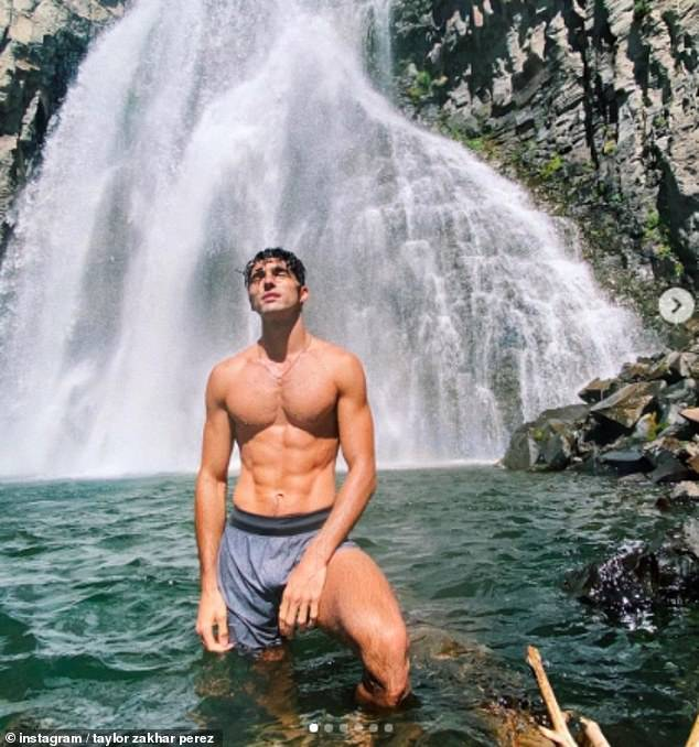 Looking good:Taylor exuded confidence as he showed off his ripped physique while posing in the clear blue waters