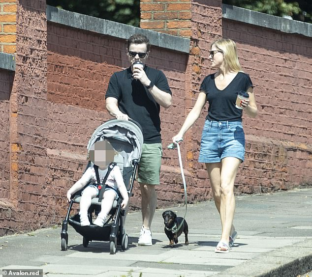 Family time: Dec presented casually in a pair of khaki shorts and a black polo shirt with undertones as he strolled in the sun