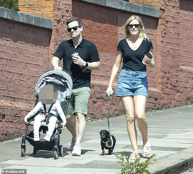 Relaxed: Declan Donnelly, 44, appeared every inch like the adored father as he pushed his daughter Isla, 23 months, alongside his wife Ali Astall, 42, and their dachshund Rocky on Sunday