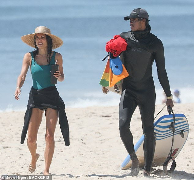 Another lesson done: The TV personality was seen making her way back up the beach with her surfing instructor