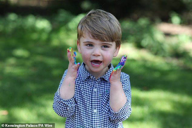 The young prince raised his rainbow-colored hands to his face, which were carefully painted on him by his mother Kate