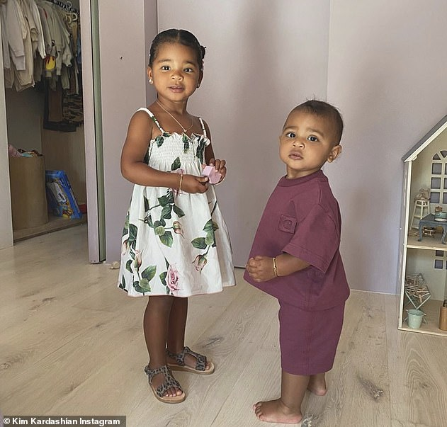 Keeping focus on something else: Kim continued to focus on her family - regularly posting photos of her children; son Psalm, right, seen with cousin True, daughter of Khloe