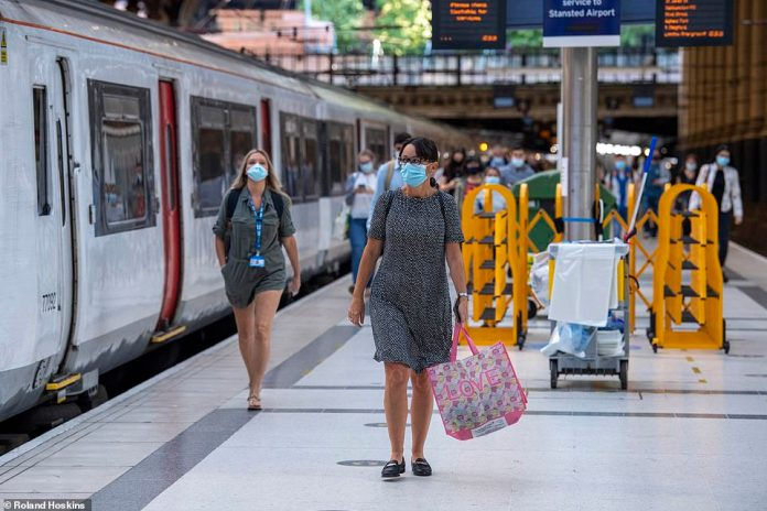 A few passengers leave the train at Liverpool Street Station this morning as they head to work in the city centre