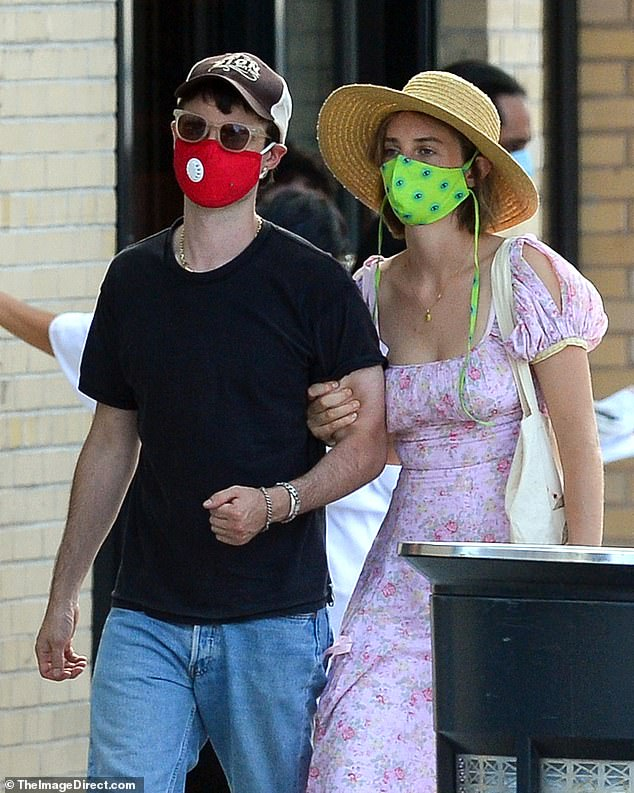 New love: Maya Hawke, 22, and Tom Sturridge, 34, appeared to confirm their budding romance as they walked arm in arm in New York City on Sunday