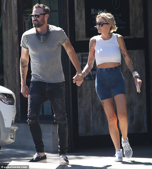 Holding hands with a new gal: Brian Austin Green has been criticized for being seen on dates with women after splitting from his wife of 10 years, Megan Fox, in May. Seen with Tina Louise earlier this month