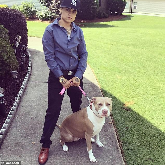 Barrow County Sheriff's deputies arrested and charged Alexandria Torregrossa (seen above with one of her pit bulls), 29, with reckless conduct