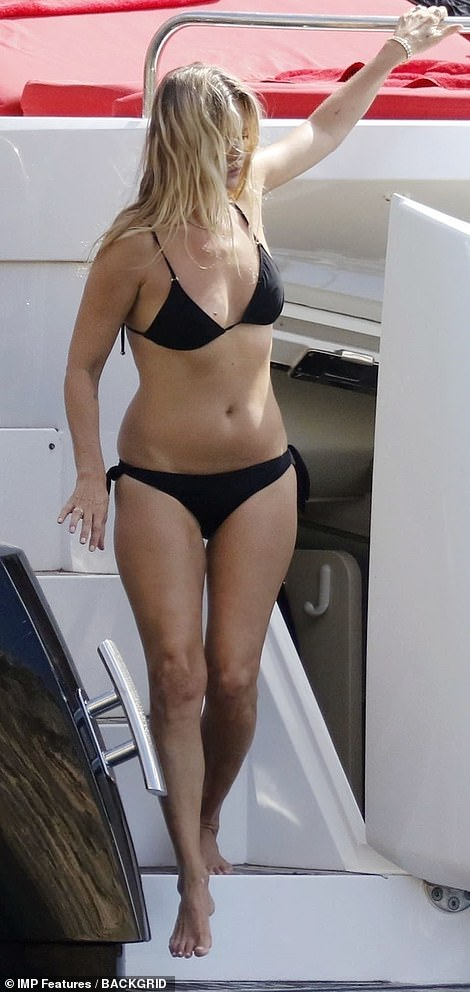 Model looks: Kate was full of confidence as she strolled around deck in her chic choice of swimwear, which flaunted her tanned figure