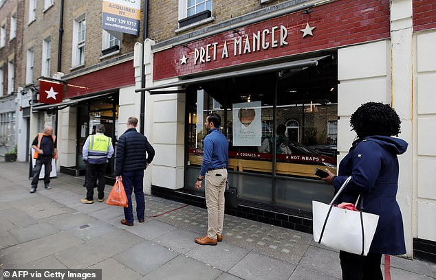 Government guidelines say the reduction must be applied all day Monday through Wednesday throughout August with no minimum spending requirement.  Pictured are customers' social distancing as they line up for a Pret A Manger in London on May 4