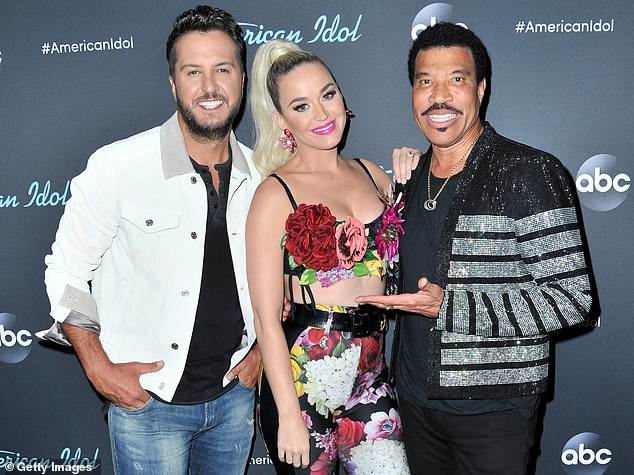 Any day now: Katys fellow American Idol judge Luke Bryan recently gave ET an update on her delivery: 'She's pretty close' (pictured with Luke Bryan and Lionel Richie in May, 2019)