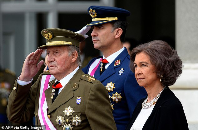 Then-king of Spain Juan Carlos (left) and Crown Prince of Spain Felipe (center) greet Spanish Queen Sofia during the Pascua Militar ceremony at the Royal Palace in Madrid