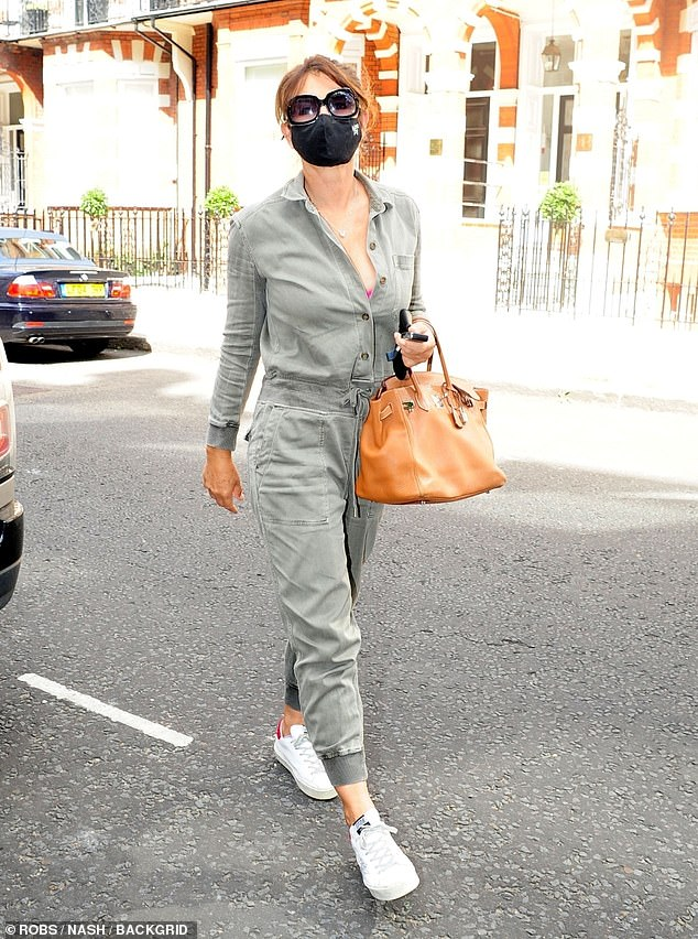 Outfit:The actress put safety first for the outing as she donned a face mask along with a grey, long-sleeved jumpsuit