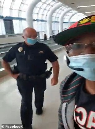 She is seen being escorted out of the airport by cops