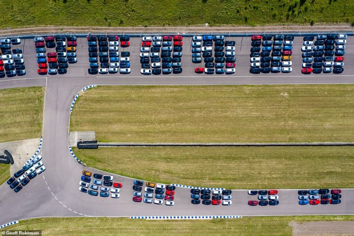 Cars are stored at the old track at Rockingham Motor Speedway in Corby, Northamptonshire
