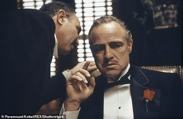 The Mafia and similar criminal groups could be dismantled by using social network analysis to map member's connections, a study has claimed. Pictured, Marlon Brando playing Mafia don Vito Corleone in the 1972 American crime film 'The Godfather'