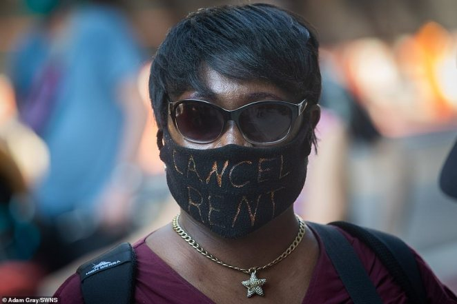 One protester wears a coronavirus face mask reading 'Cancel rent' amid calls for a ban on evictions and cancellation of rent in the Big Apple