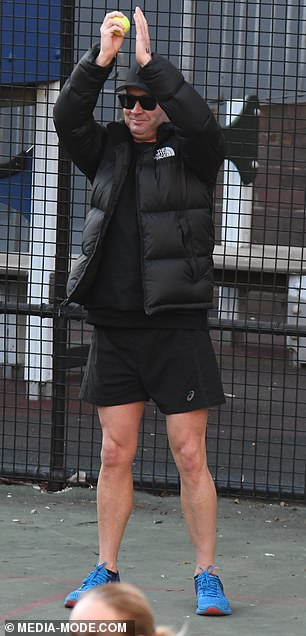 Michael (pictured) was spotted collecting tennis balls for his girlfriend as she practised playing the game