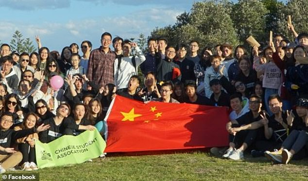 A university is now standing up to China and admitting it was wrong to delete social media messages in support of harassed Hong Kong democracy campaigners. Pictured is a Chinese Student Association UNSW at an unrelated event in 2019. Theyattend a university that is particularly dependent on international students