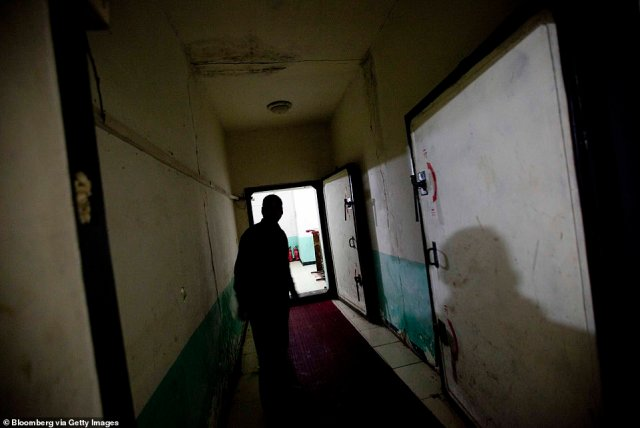 A man walks down a hallway at a housing complex inside a Chinese air defense bunker in the outskirts of Beijing. Some of the residents have lived in the complex for decades, while others use the bunker as a stop gap before finding a place to live above ground