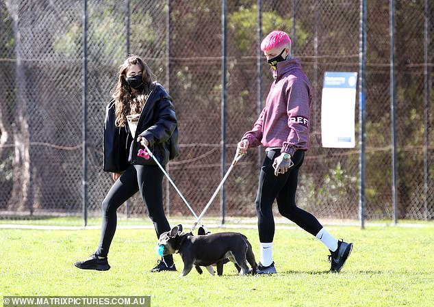 On to the next? It appears that Ciarran Stott [pictured] has moved on from Kiki Morris, as he enjoyed a date with a mystery brunette [pictured] at a dog park in Melbourne on Thursday