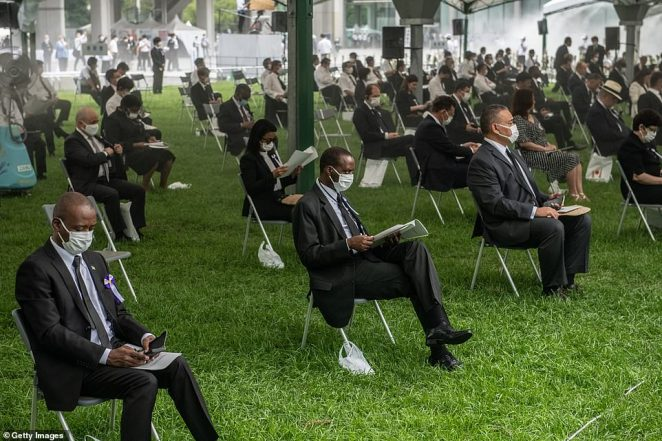 Attendees sat for a socially distanced ceremony to mark the75th anniversary of the Hiroshima atomic earlier today amid the coronavirus pandemic
