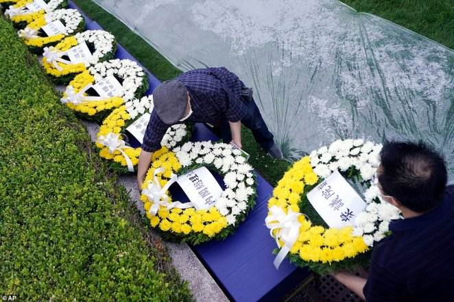 Workers prepared a series of wreaths for the atomic bombing victims before the start of a ceremony which were later laid inHiroshima's Peace Memorial Park