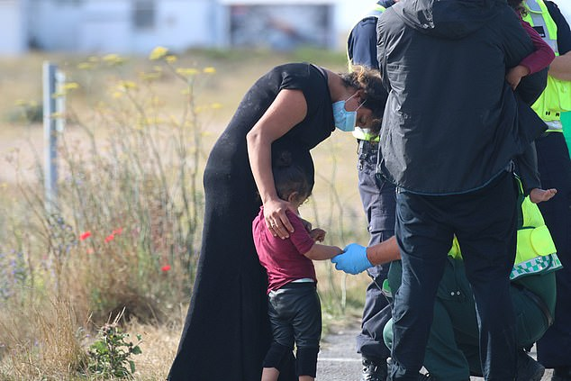 It means 3,643 migrants have made the life-risking Channel crossing this year - nearly double the 1,850-odd who arrived in the whole of last year. Pictured: A child being checked by officials