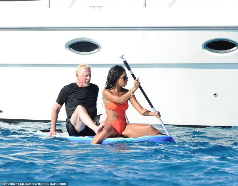 Chilling: Lillian took charge as she sat at the front of the blue board, pushing the couple along while rowing with an an oar as Boris relaxed while sitting behind her