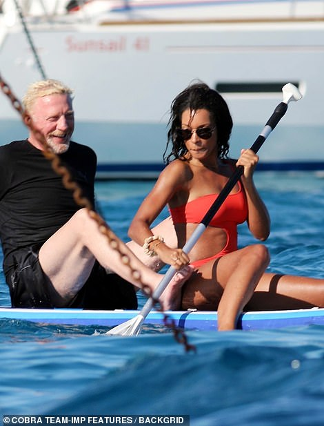 True blue! They have been making the most of the good weather on their sun-soaked trip with Boris' son