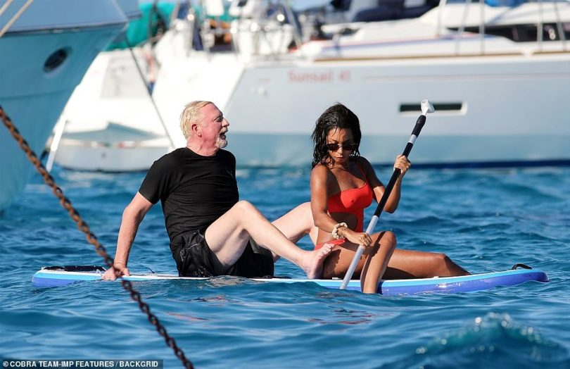 Moored: The couple made their way through several expensive-looking yachts on the paddle board